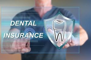 "A dentist with ""Dental Insurance"" and a tooth in front of him"