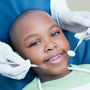 Young boy being examined in dental chair