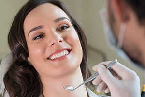 Woman smiling jovially in dental chair