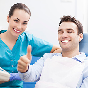 Pleased Male patient giving an enthusiastic thumbs up