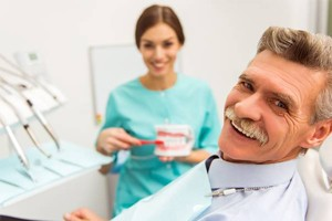Senior man smiling in dental chair