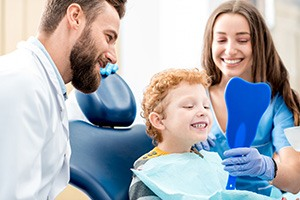 Smiling boy in dentist chair