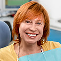 Sparks Dental Services lady with red hair smiling