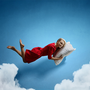 person sleeping on a pillow in the sky