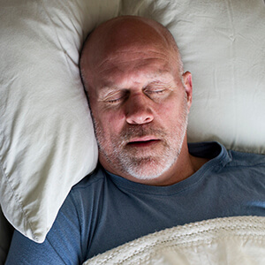 Sparks Sleep Apnea Therapy man in soundly sleeping