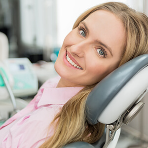 lady on reclined dental chair grinning