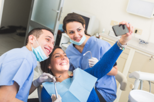 woman taking selfie with dentist