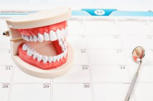 dental tools on calendar