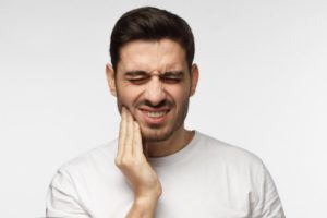Man with tooth pain.