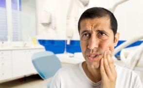 Distressed man in pain before seeing an emergency dentist