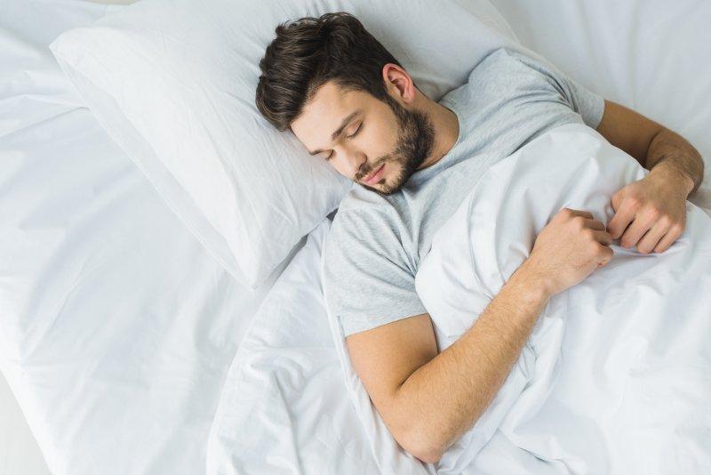 A man completing a sleep test.